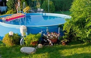 Small soft-sided above ground swimming pool in a small yard