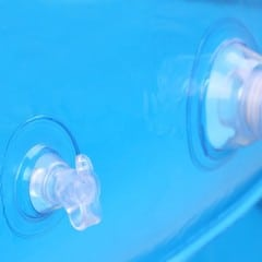 Extreme closeup of the air valve of an inflatable swimming pool